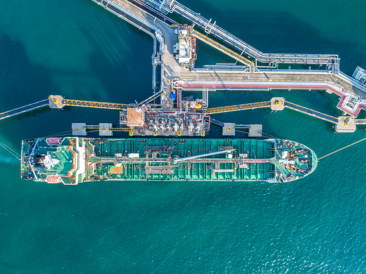oil tanker, gas tanker in the high sea.Refinery Industry cargo ship,aerial view,Thailand, in import export, LPG,oil refinery, Logistics and transportation with working crane bridge in harbor