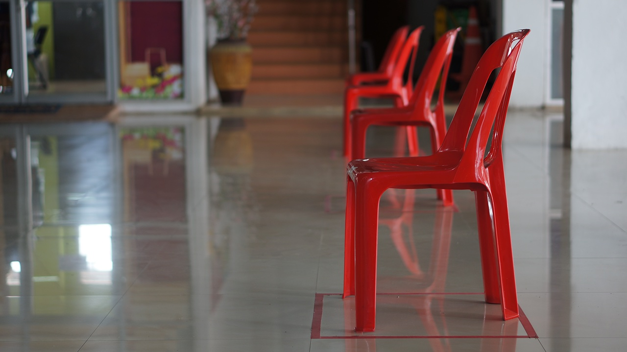 close up red chairs social distancing
