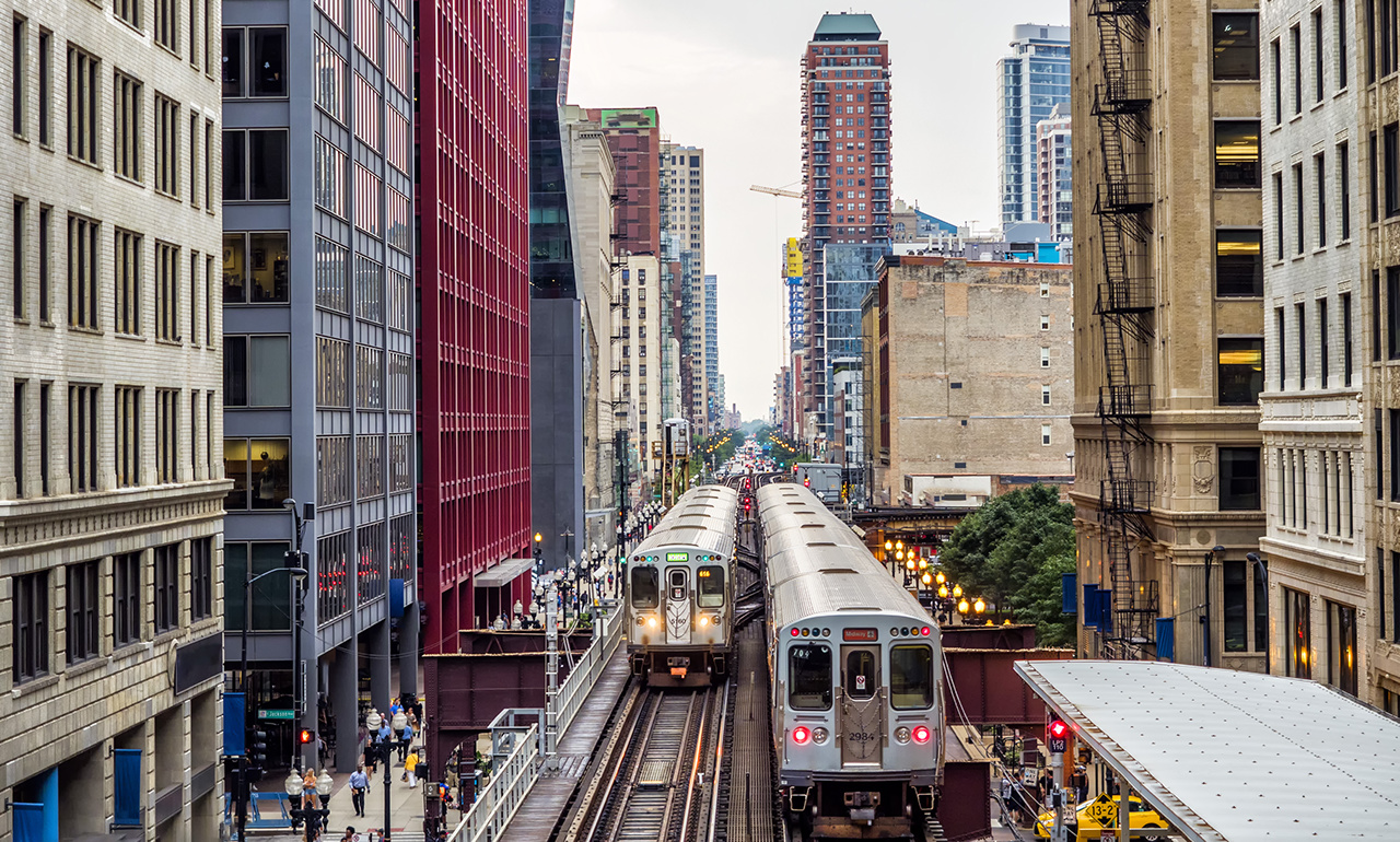 Elevated Train Tracks above the streets and between buildings at The Loop - Chicago, Illinois, USA