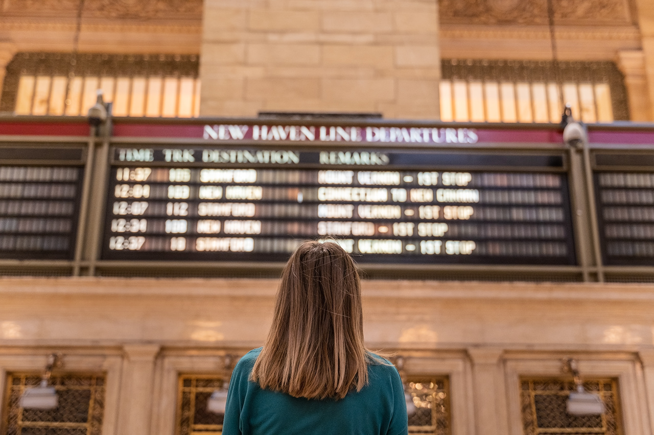 timetable checking before the train ride in new york