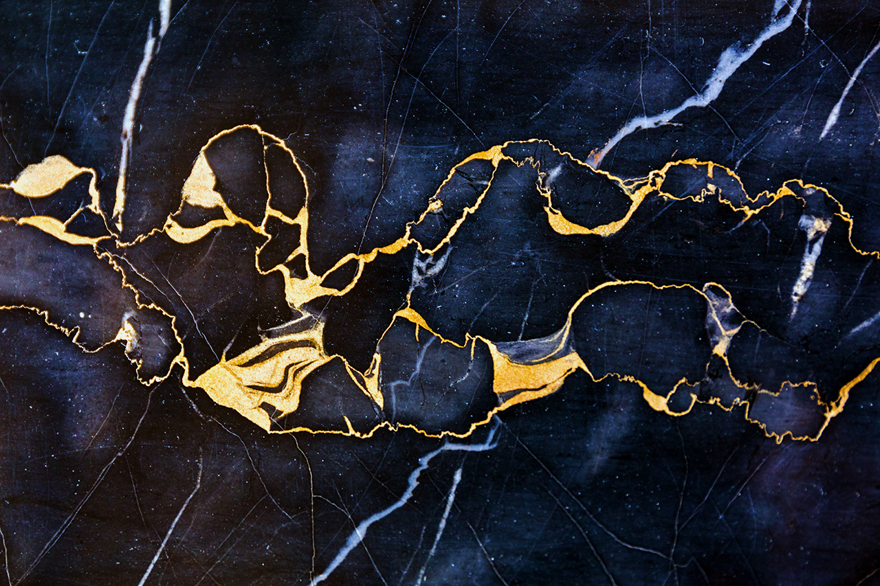 Golden Veins in Dark Marble Stone Luxury