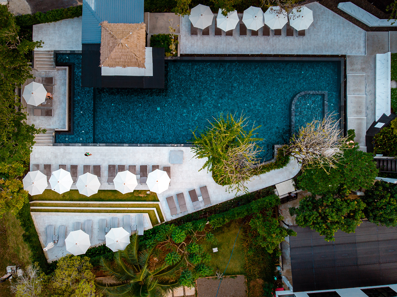top view swimming pool, drone view pool, couple in swimming pool during vacation in Thailand Asia