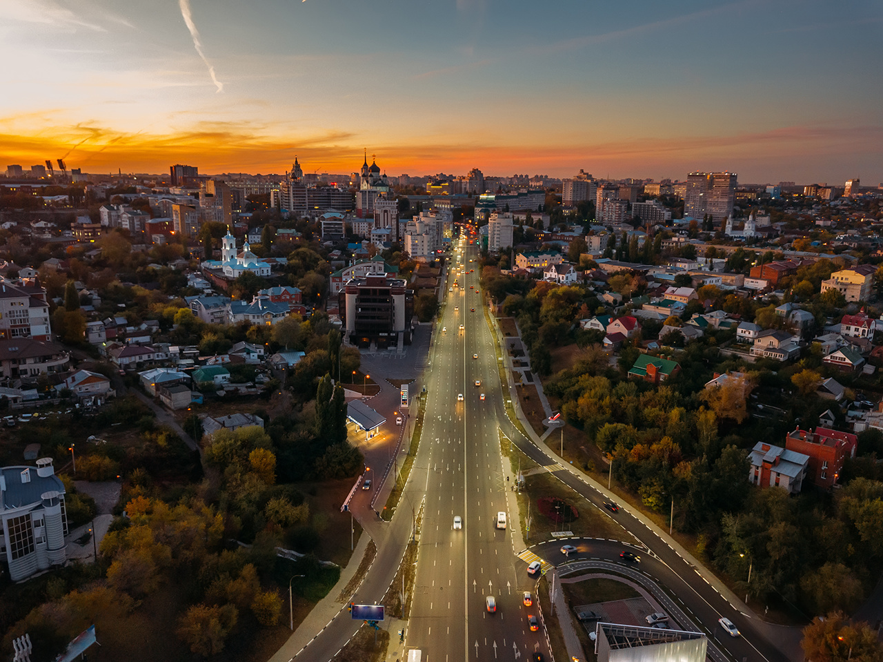Night Voronezh, aerial view of city with illuminated road.