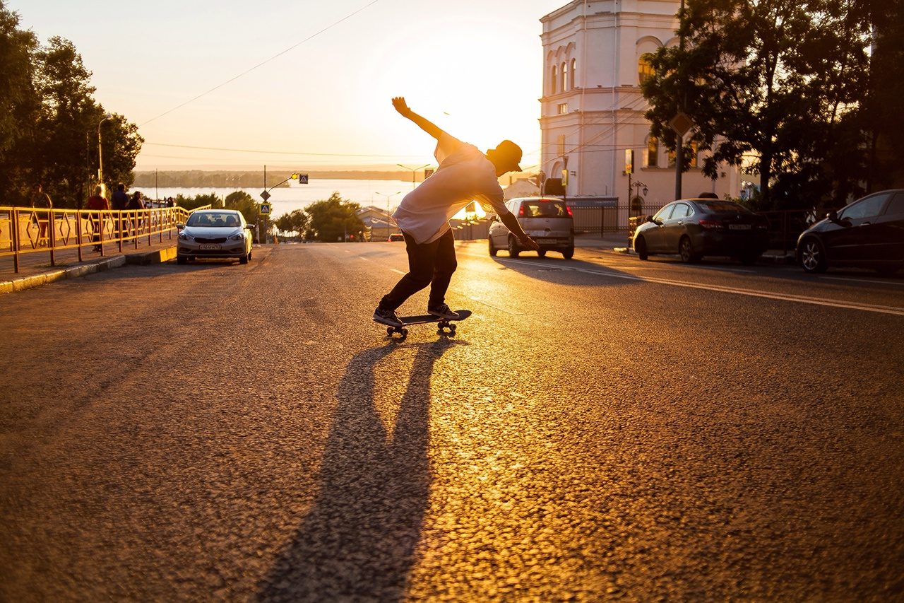 Rear View Full Length Of Man Skateboarding On Road During Sunset8