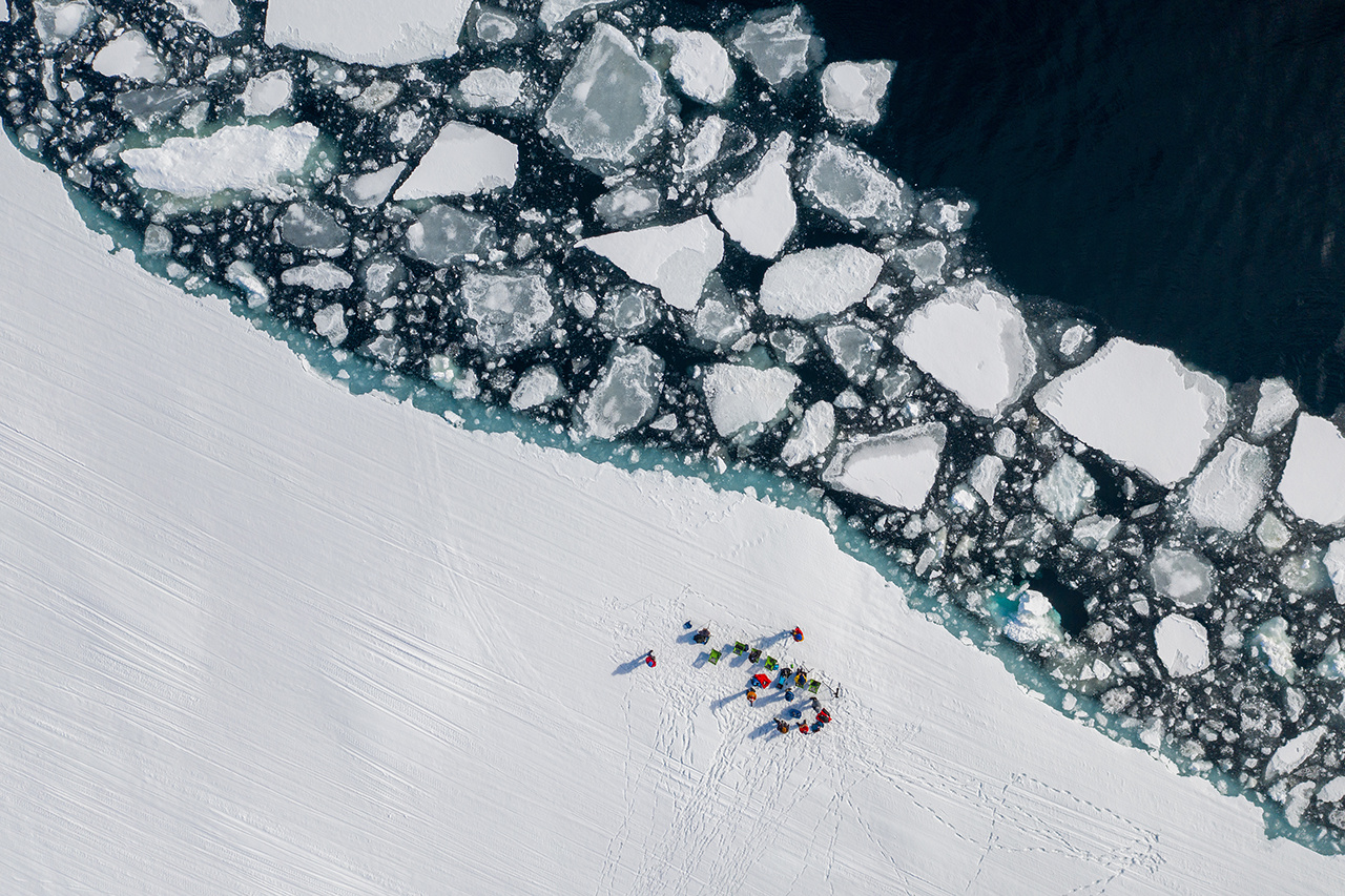 Aerial drone photo of tourists visit the floe edge near Sirmilik National Park in Nunavut, Canada